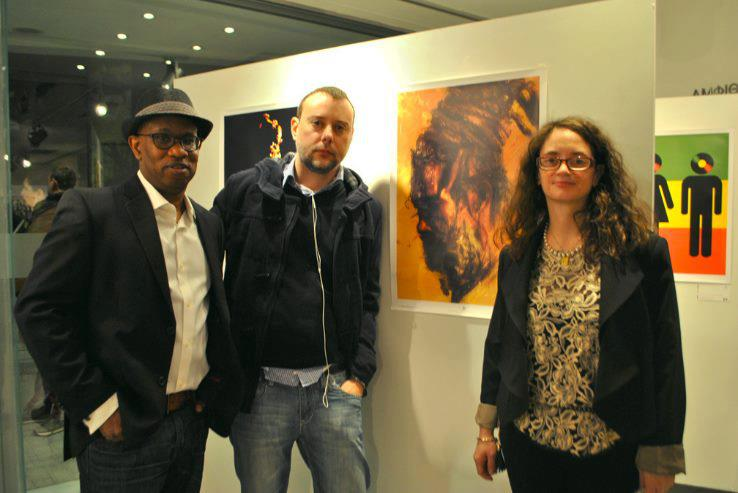 The 10th place winner, Dimitris Evagelou from Greece next to his poster with Michael Thompson and Maria Papaefstathiou.