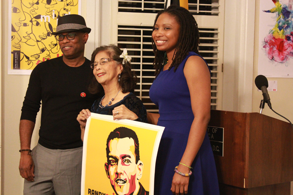 "Michael Thompson presents his ""Randy Chin"" poster to Patrica Chin, founder of VP Records"